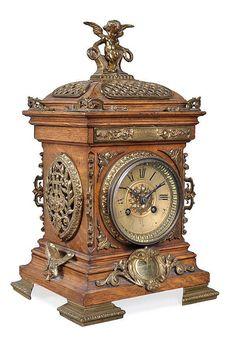 "French gilt brass mounted oak mantel clock by Bushell, York, circa 1900; 8-day gong striking movement. 14"" h."