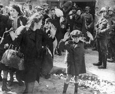 Nazi Soldiers evecting Jews from their hiding places raising their hands in surrender, amongst them a young boy , Warsaw Ghetto, April 1943  Photographs  Film and Photo Archive, Yad Vashem  All rights reserved