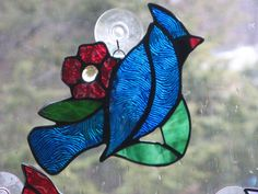 Stained Glass yellow or blue bird. $31.00, via Etsy.