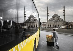 The photo was taken in Eminˆn¸ square which one of the largest squares in Istanbul. There are two images reflected from the bus glass. One of them is a boy who distributes bread to groceries, the other one is historical ottoman mosque. This is a souvenir photo that couldn't encountered in all the time. (Photo and caption by Sami Uaan/National Geographic Photo Contest)