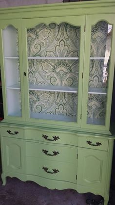 """China hutch, 68.5 """" high, 45 """" wide, 15"""" deep. Chalk painted in Belle grove sorbet ( interior ) and brush meadow exterior  with a hand rubbed paste wax finish. Drawer and back  hutch lined with a paisley fabric.  $325 OBO."""