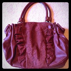 Burgandy purse with lace panel Burgandy faux leather bag with lace panel in front and braided straps. Like new condition! Bags Shoulder Bags