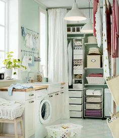 Cute laundry room! Uses old baby clothes as part of decoration. Butcher block counters. #organized