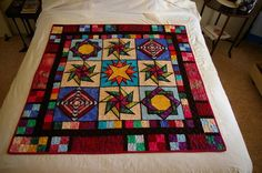 24 Blocks - Stained Glass paper pieced quilt by Debbie Spendley