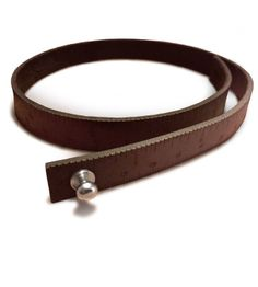 Wrist Ruler is a leather wristband with engraved inch and centimeter measurements.