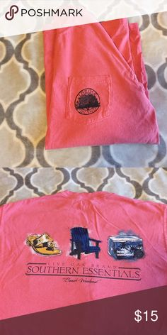 "Live oak brand t shirt Coral live oak brand frocket t short. Southern essentials ""beach weekend"" on the back with jack Rogers sandals, beach lawn chair and a cooler. Comfort colors!! Live oak brand Tops Tees - Short Sleeve"