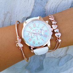 Bracelet Stack Includes: Rose gold cuff with a bedazzled butterfly cuff. Vegan leather bracelet with roman numerals and rose gold accent. Chain link bracelet with small heart charms.