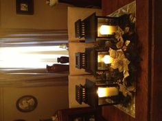 Holiday centerpiece.  Lantern arrangements?