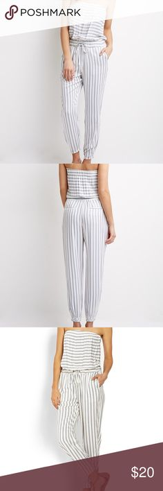 """Forever 21 Striped Jumpsuit Forever 21 Striped strapless Jumpsuit. Size Large. Adjustable tie-waist with inner elastic band. Purchased from forever21.com but tag says """"life in progress. Super lightweight and comfy! Forever 21 Pants Jumpsuits & Rompers"""