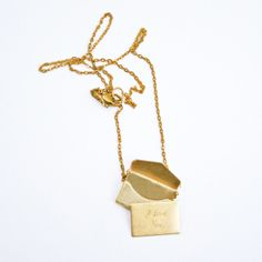 a necklace with a personalized love note inside