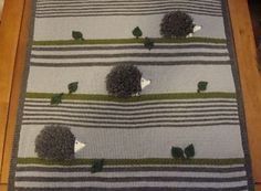 I want to call them hedgehogs instead of porcupines... Knit Witts Yarn Shop Porcupine Blanket Kit.