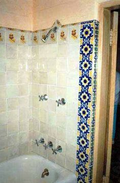 Marilyn's bathroom was decorated with hand-picked Mexican tiles, on the walls, above the sink and around the bathtub.