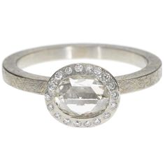 Todd Reed (love him). This may or may not be up there on my dream ring list. Raw diamond, distressed band, and understated : )
