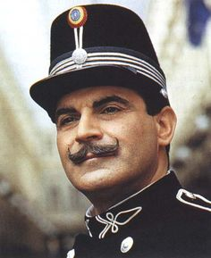 Hercule Poirot in his early life. Attired in his Brussels police uniform - itself frogged and trimmed in Art Neuvo (not Deco) manner.