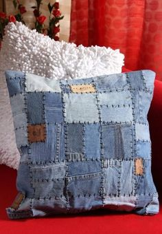 Denim Patchwork Cushion Cover There's always those jeans that aren't quite in fashion anymore, never really fitted, grown out of, think I would add a pocket, for TV buttons, or my phone, always losing things under cushions.