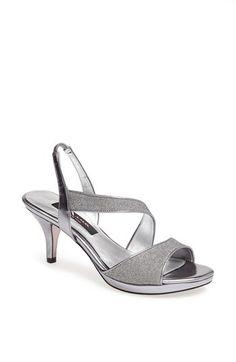 Nina 'Newark' Sandal at Nordstrom.com. Sinuous asymmetrical straps shape a mesmerizing slingback sandal alight with metallic shimmer.