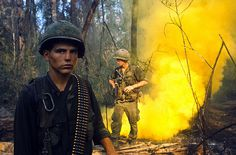 Soldiers Standing Near a Cloud of Yellow Smoke, Hue, South Vietnam, by Kyoichi Sawada