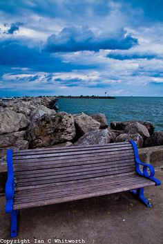 Your bench awaits in Bronte Harbour, Oakville with an interesting sky in the background.