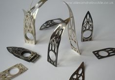 Sterling silver rings abased on three different church window designs, by Alexandra Buckle