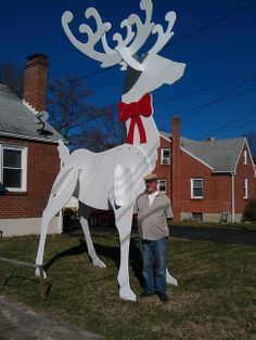 2nd photo :)   Donald Johnson, 76, a retired mailman  erected what may the largest lawn ornament in town — at least so far.  It's a 16-foot-tall painted-white reindeer, cut out of sheets of plywood, held together via tab-and-slot construction, plus five steel lag bolts.