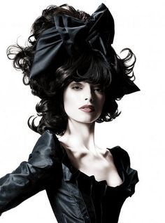 Go Sleek and Go Black. Ape a large hat with a massive bow.