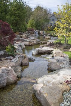 A long stream runs into a recreation pond in the suburbs of Chicago #pond #stream #waterfall
