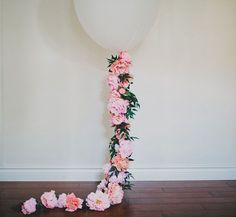 DIY Floral BalloonHere at GWS we are big fans of balloons (remember this other DIY Giant Balloon we did?) and so today we paired up with Afloral to put a twist on the giant balloon tassels  just add flowers! Or more specificailly, those all-too-gorgeous