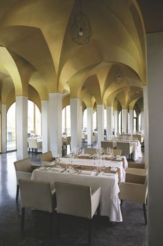 At Vajra restaurant, silver columns and ceilings with golden arches define individual spaces for each of the tables arranged to maximize space and movement.