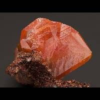 Discovered in 1845, the mineral Wulfenite, is named after Austrian Jesuit mineralogist Franz Xavier von Wulfen, who authored a monograph on the lead ores of Bleiberg, Austria. Wulfenite forms square shaped, tabular crystals and also prismatic crystals. Other habits are massive and granular. Wulfenite is typically colored orange or yellow but may be brown, gray, or greenish brown. The colors often appear brilliant. Wulfenite forms in the parts of the ore veins that have been altered by…