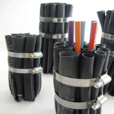 Inner tube sections into vase or pencil cup.