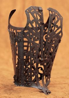 Corset, c. 1580-1600, French. Iron with scroll motif; one front and two back pieces; opening at center-back. Inv. AC9250 95-45. Gift of Wacoal Corp.