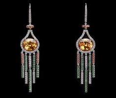 """Mandarine garnet drops """"Natalie"""" earrings -  Delicate drop earrings feature a pair of oval Mandarine garnets accented with diamonds and tsavorites precisely set on white gold bars that swing like jeweled wind chimes."""