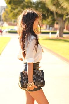 Sheer white button-up with tight black mini. Cute black studded purse.
