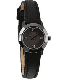 This watch is a sleek and feminine design that is made with studded indices on a stainless steel case that accent the Black genuine leather strap with an adjustable buckle.
