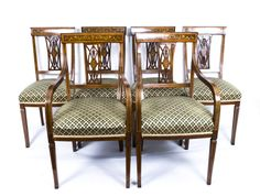 A handsome set of 6 antique Edwardian inlaid mahogany dining chairs.