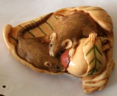 Vintage Japanese hand-carved bone netsuke. Mouse on leaf lychee