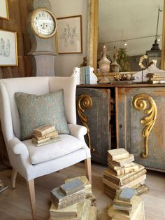 Beautiful gilded fragments attached to a Swedish cabinet.  interior designer Brooke Giannetti