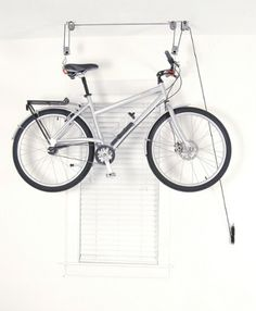 The El Greco Ceiling Hoist raises your bike up and out of the way so you can free up space in your garage, loft or walk-in closet. Available at REI, 100% Satisfaction Guaranteed.