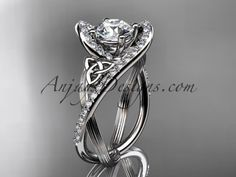 """platinum diamond celtic trinity knot wedding ring, engagement ring with a """"Forever Brilliant"""" Moissanite center stone CT7369"""