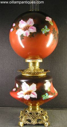 "This is one of the largest antique parlour or ""Gone with the Wind"" oil lamps we have come across. The globe shade is 12″ in diameter and the height of the kerosene lamp to the top of the chimney is approximately 30″. The beautiful hand painted globe shade and vase are completely matching and original to each other."