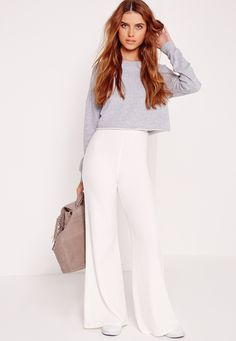 Widen your style taste in these ultra-chic wide trousers. Featuring a classic…