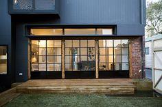 Steel doors, exposed brick, deck