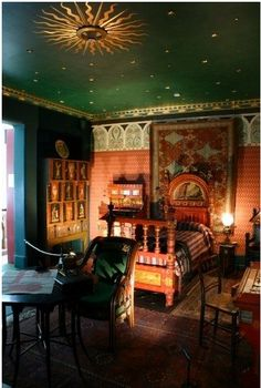 Victorian Boho styled child's room. Notice the different layers of rugs on the floor, wallpaper on one wall, paint another and the celestial ceiling. An oriental carpet is hung behind the bed, another layer to add to the look. What do you think?