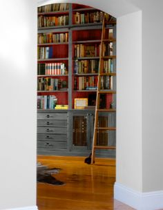 Accent colors are a great way to change the overall look and design of a room without spending too much money or time on a project. Learn the best tips here: Red Bookcase, Bookcases, Distressing Chalk Paint, Built In Hutch, Distressed Painting, Living Spaces, Living Rooms, Distressed Furniture, Real Simple