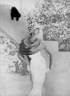 White sharskin dress and polka-dot stole by Vera Stewart, polka-dot hat by Emme, photo by Richard Rutledge, Vogue 1957