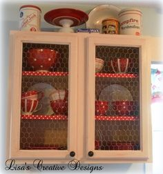 The reds in this cabinet pop...love the cracker jack tin