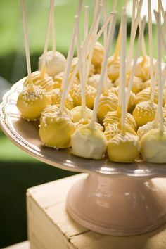 """Wedding sweet table. White & yellow wedding. Cakepops from """"Tout Sweet Delectable Desserts"""" https://www.facebook.com/toutsweet?ref=ts=ts    Photo by Dan Miller"""