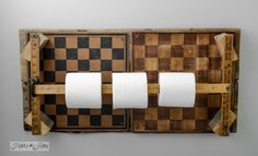 Checkerboard Yardstick Toilet Paper Holder.  This could work for paper towels in the kitchen, too.