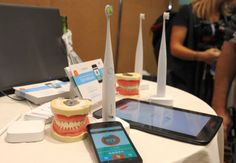 """The Kolibree toothbrush, the world's first Internet-connected toothbrush, is displayed """"CES: Unveiled,"""" the media preview for International CES, at the Mandalay Bay Convention Center in Las Vegas, Nevada. The Kolibree toothbrush includes a sensor which detects how much tartar is being removed in a brushing. It also records brushing activity so users can maintain a consistent cleaning each time.  The device conveys the information wirelessly to a smartphone app."""