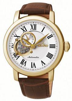 Montre Homme Seiko SSA232K1, bracelet en cuir marron et boîtier acier doré, cadran blanc avec une partie squelette.